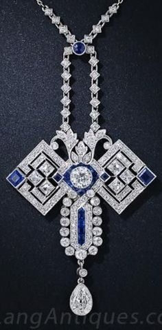 An Art Deco Platinum, White Gold, Diamond and Sapphire Necklace, 1920s. Set with European-, French-, antique single-cut and pear-shaped diamonds, and calibré sapphires. Pendant 2 inches long. #ArtDeco #pendant