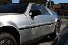 A DeLorean outside the Garage 77 in Los Angeles Garage, Cars, Vehicles, Carport Garage, Autos, Garages, Car, Car, Automobile
