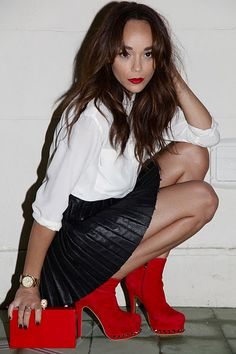 LOVE her on Revenge and love her pops of red against her leather skirt