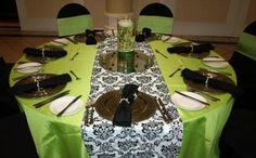 I'd definitely do leopard print as the big table cover & our green as a smaller cover to go over the top.
