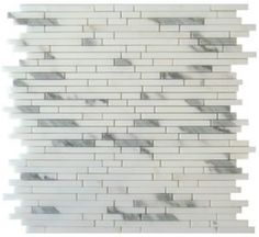 1/2+x+Random+Strip++Italian+Calacatta+Gold+Marble+Polished+Mosaic+Tile+-+1/2+x+Random+Strip+Italian+Calacatta+Gold+Marble+Polished+Mosaic+Tileis+a+great+way+to+enhance+your+decor.+This+Polished+Mosaic+Tile+is+constructed+from+durable,+impervious,+translucent,+Marblematerial,+comes+in+a+smooth,+high-sheen+finish+and+is+suitable+for+installation+as+bathroom+backsplash,+kitchen+backsplash+in+commercial+and+residential+spaces.+This+beautiful+Marbletile+features+a+random+varia