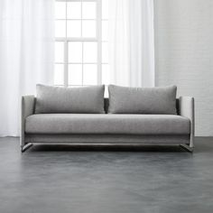 Shop Tandom Dark Grey Sleeper Sofa. Ingenious sleeper transforms from sofa to guest bed in clever 1-2-3 setup. Modern design sits deep with oversized back cushions on polished metal tube frame.