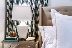 indigo pattern curtains + mirrored chest + wingback headboard