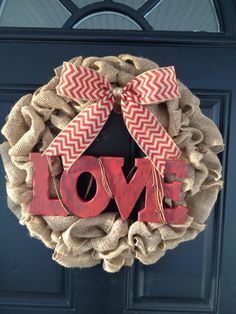 "Handmade, personalized Valentine's Day burlap wreath with the wooden word ""LOVE"" on Etsy, $55.00"