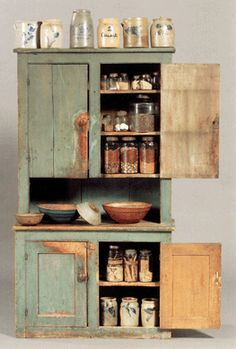 The blue-green painted step back cupboard realized $2,370, a small light blue wooden bowl brought $3,437, a larger bowl in blue was $3,318, and a bowl in red realized $1,067 (Whittemore collection).