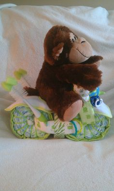 side view of monkey motorcycle diaper cake