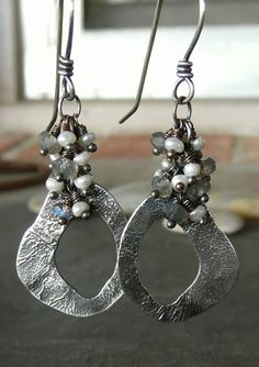 This beautiful pair of earrings is completely hand crafted by me. I hand cut the rustic hoop out of reticulated sterling silver. The reticulated silver has beautifully rustic ripples throughout that I created by carefully heating the surface of the metal. I attached the rustic hoop to