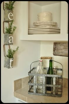 Great idea for that small space on the side of oven between cabinets minus the greenery