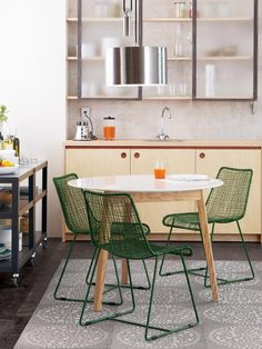 Everything in this kitchen is liked by me. Green chairs refreshingly different. Barely-there cabinets nice.