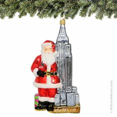 Polonaise Santa and Empire State Building Christmas Ornament, Glass Using the traditional Polish hand blown and painted glass tradition, enjoy this Santa and Empire State Building Christmas ornament for your cherished Christmas tree. 7 inches tall (http://www.nycwebstore.com/polonaise-santa-and-empire-state-building-glass-christmas-ornament/)