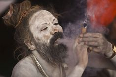 """A Sadhu, or a Hindu holy man, smokes marijuana on a chillum on the banks of river Ganges ahead of the """"Kumbh Mela"""" (Pitcher Festival) in the northern Indian city of Allahabad. Man Smoking, Smoking Weed, Rasta Dreads, Aghori Shiva, Kumbh Mela, Indian Festivals, The Old Days, Hinduism, Summer Of Love"""