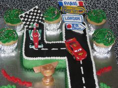 CARS 2 Birthday Cake! - Customer wanted a number 4 but wanted it CARS-themed. I decided to make it into a racetrack, with help and inspiration from my fellow CC buddies! Everything is edible, other than the cars and Mater.