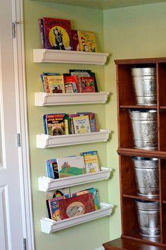 Rain Gutter book shelves behind a door. Galvanized Paint Buckets for everything else . . . indestructible!!!