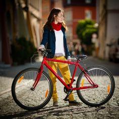 Urban biking - girl and bike in city Stock Photo