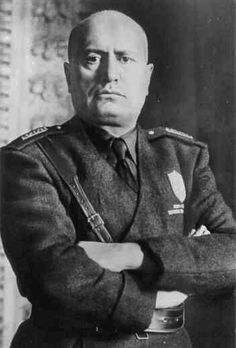 """Rise of Fascism in Germany and Italy: Benito Mussolini founded the Fascist Party in Italy in 1919.  By 1925, Mussolini had firmly established himself as Italy's military dictator and was called Il Duce, or """"The Leader.""""  Mussolini would ultimately align Italy with Nazi Germany as part of the Axis Powers of World War II."""