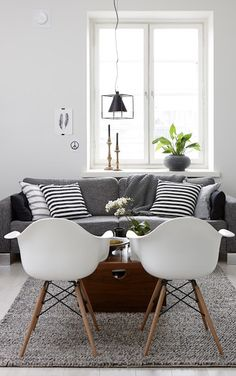 smaller chairs like this might be nice also, in place of pouffs or ottomans. they can be flipped around easily to face the dining area or the tv