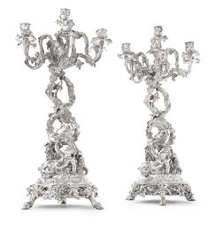 A Pair of Napoleon III silver-plated seven-light figural candelabra, Christofle, Paris,  1863-64 and 1868-69