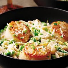 Creamy Scallop & Pea Fettuccine  This rich pasta dish is full of sweet seared scallops and plump peas. Low-fat milk and flour thicken the sauce, giving it creamy texture without the extra calories and fat found in traditional cream sauces. Serve with a small Caesar salad on the side.