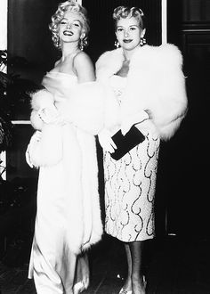Marilyn Monroe and Betty Grable at Walter Winchell's birthday party, 1953