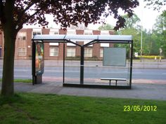 Bus Stop Shelter A bus stop shelter with limited seating facilities where two to three people can sit on the bench, the walls and roof are made out of glass. The designation of this bus stop. Bus Stop Design, Public Transport, Shelter, Glass, Inspiration, Biblical Inspiration, Drinkware, Corning Glass, Yuri