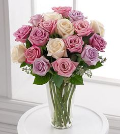 Birthday Flowers - FTD Long Stem Pastel Rose Bouquet - DELUXE - A delightful study in pastels, this collection of pale pink roses, blush roses, pale yellow roses and pale lavender roses makes an exquisite bouquet. All are arranged with fragrant seeded eucalyptus in a classic clear glass vase.