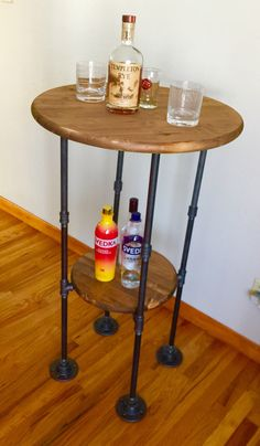 Black Pipe Pub Table 24 round top with 15 shelf 41 tall Wire Spool Tables, Diy Table Legs, Round Shelf, Outdoor Bar Stools, Diy Stool, Pub Decor, Pipe Table, Plumbing Problems, Black Pipe