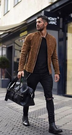 18103b9b39 with a fall streetwear idea with a brown suede button up jacket black shirt  black ripped jeans black leather duffle bag black chelsea boots