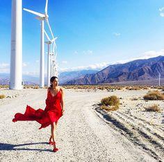 Nicole Warne of Gary Pepper Girls wears a red maxi dress with red Aquazurra heels