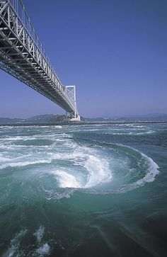 Onaruto Bridge connecting Kobe and Naruto, Tokushima, Japan. The bridge is one of the largest bridges in the world and is also known for the Naruto whirlpools. The Naruto whirlpools are caused by tidal currents between the Seto Inland Sea and the Pacifi Tokushima, Places Around The World, Around The Worlds, Beautiful World, Beautiful Places, Awaji Island, Naruto, Ouvrages D'art, Natural Phenomena