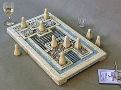 Knossos game is the ancient board game discovered by Evans in the Palace of Knossos and goes back to 1600 BC. Tetraktis-studio