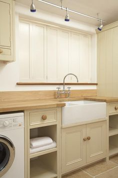 Solid Shaker style shutters, off-white painted Tulipwood, Utility room
