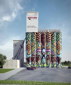 Art mural by Rick Sinnett on the side of the old grain elevator - now a rock climbing facility - in Bricktown, OKC (in progress)