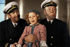 Shirley Temple with Guy Kibbee and Slim Summerville in the Finale of Captain January, 1936. I love Shirley's face in the first GIF.