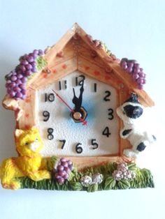 CAT AND DOG CLOCK BOXED, IDEAL GIFT, BATTERY OPERATED 1 X AA (PENLIGHT SIZE) wonkydragon http://www.amazon.co.uk/dp/B00FG7RS1Q/ref=cm_sw_r_pi_dp_wQdIvb08FF412