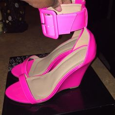 Hot Pink Wedge Shoe Get this super hot pink wedge heeled shoe. Made of patent leather material. This show is super cute, girly and has a big buckle, which gives off one of its best details. Liliana Shoes Wedges