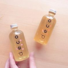 a nourishing, aromatic green beauty essential: body oils in mandarin + jasmine and vanilla + rose. available at deconaturals.com