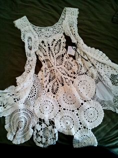 createcreatively: Old doilies pieced together into a vest. So delicate and still modern, with the asymmetrical design. Made by Marijo Brow...