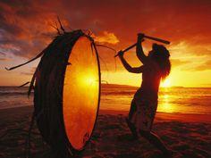 Native Hawaiian Man Beats His Drum on Makena Beach at Sunset   by Mark