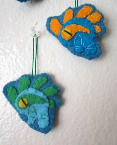World of Warcraft Murloc ornaments or keychains, great idea for Stocking Stuffers. Or instead of a bow on a small package, add a Murloc! Who can resist these cute little, and sometimes annoying creatures? Random colors are ready to ship for $5 plus $1 shipping, or if you prefer a custom color, just $1 more for custom color (plus the $1 shipping fee = $7)  Shown is a school of Murlocs...or are they considered a pack of Murlocs? A gaggle? Hmmm Listing is for 1 Murloc only, and random means...