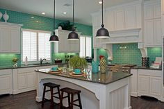 Aqua glass-subway tile in a white kitchen, colors that pop! Found at http://www.subwaytileoutlet.com/