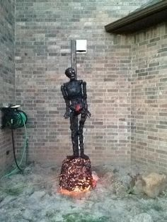 burned at the stake, just the pic. Good idea for the witch scene. Could build a log looking wood base with one of the plug in fire cauldrons in the middle?