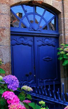 Beautiful indigo blue door and transom window