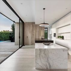 Beautiful finishes in this classic kitchen by with the marble, oak and white cabinetry. Love the open layout and that stunning two level island bench. Interior Design Examples, Interior Design Inspiration, Kitchen Inspiration, Minimalist Kitchen, Minimalist Decor, Minimalist Style, Minimalist Design, Minimalist Lifestyle, Minimal House Design