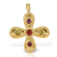 Byzantine gold cross by ilias Lalaounis for myhydrasophiadelachouvel with tourmalines and amethyst available at the yachtclub of Monaco