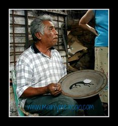 Grand Master, Salvador Vasquez at his home workshop in Tonala demonstrating his skill with clay - he is well known for his use of Naguales on pottery & is painting one here in the center of the plate.  Many years ago he worked along with Jorge Wilmot to paint the pieces Jorge designed.  See more in our website shop www.mainlymexican.com #Mexico #Mexican #vintage #antique #folkart #collectible #art #ceramic #clay #artisan
