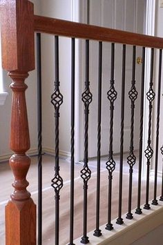 how to install wrought iron stair spindles