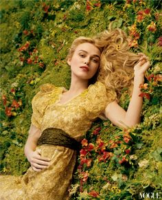Keira Knightley in a Vera Wang gold flower-decked dress. (photographed by Annie Leibovitz, Vogue, December 2005)