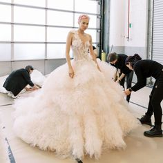 These are the latest Bridal Fashion Week wedding dress trends for fall according to Brides editors. Peacock Wedding Dresses, Butterfly Wedding Dress, Pnina Wedding Dresses, Fairy Wedding Dress, Wedding Dress Trends, Wedding Dress Styles, Designer Wedding Dresses, Modest Wedding, Bridal Fashion Week