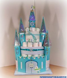 Elke is getting ready for a new little guy ready to make his entry in the family by making her niece this magical Fairytale Castle Diaper Cake from TINY MIRACLE SVG KIT.  Great embellishing and the iridescent panels on the towers are so cool!  Perfect gift for the new mom!
