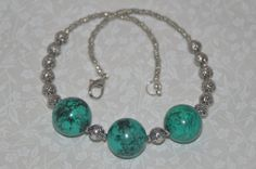 $45.00  Magnesite Turquoise and Pewter Necklace and Earring by Its The Beads on Etsy.  Handmade chunky graduated Magnesite Turquoise necklace made with three 22mm focal point Magnesite Turquoise stones, complimented by 8mm pewter beads, and finished with tiny 3mm pewter beads.   Necklace is 18 inches long,